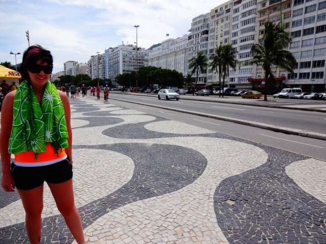Laura on the sidewalk beside Copacabana beach