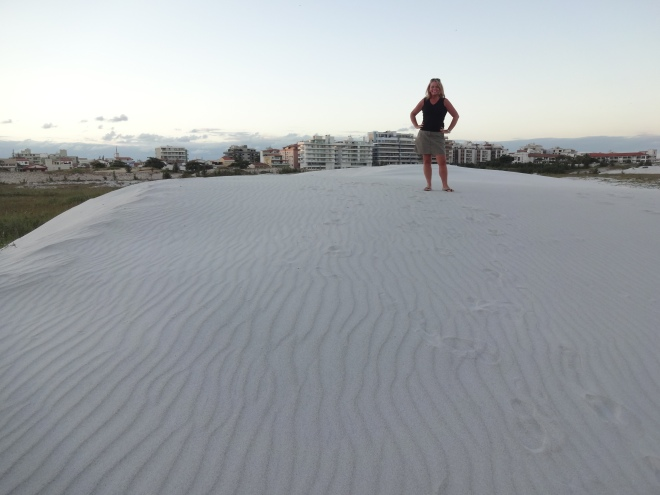 Standing on a white powdery sand dune