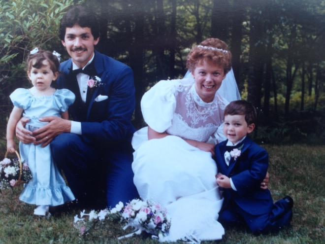 David & I at our wedding with our flower girl and ring bearer (Richard)