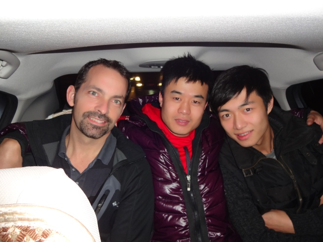 The three guys squished in the back seat :D