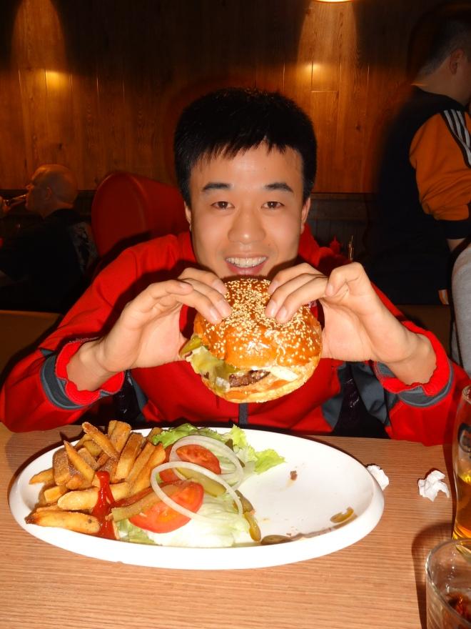 Yan Bing with his burger