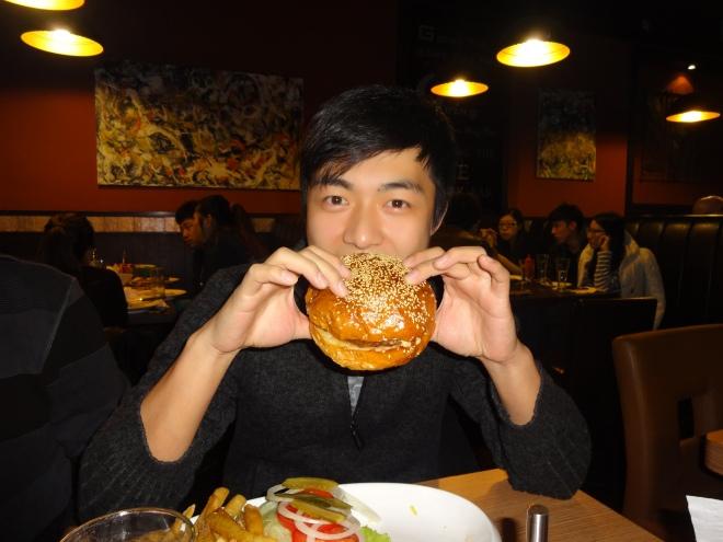 Wang Zhi Cao with his burger