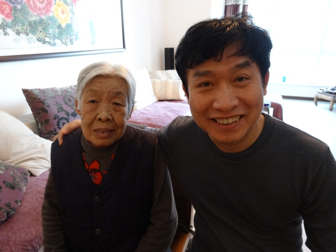 Wei Quan with his Mother. She is very proud of him and her grandson who is studying in Canada.